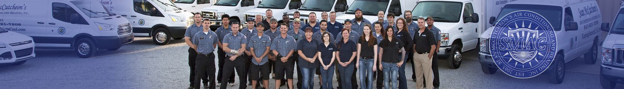 Sean McCutcheon's Air Conditioning and Heating team in front of the SMAC fleet